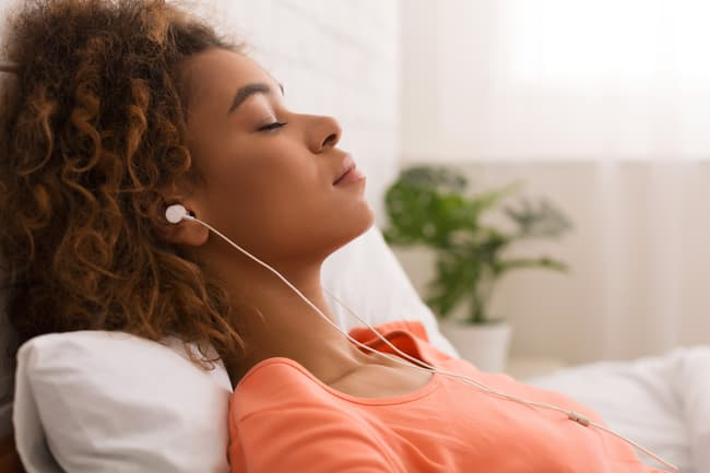 photo of woman relaxed listening to music