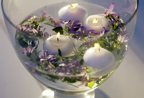 Floating candles and lavender in glass vase
