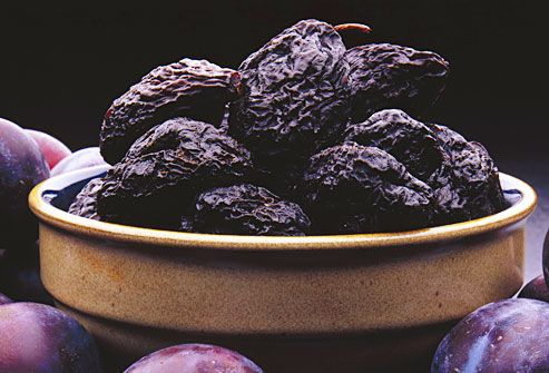Prunes in crockery bowl