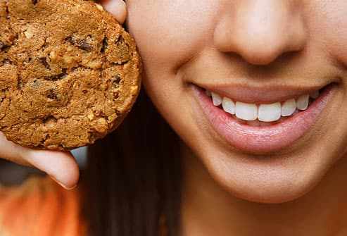 girl holding cookie
