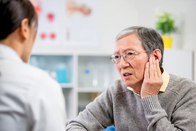 photo of man talking to doctor