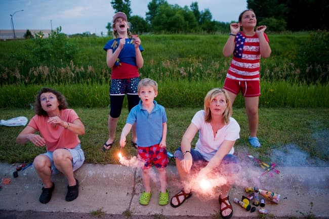 photo of family watching fireworks