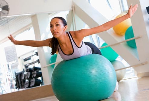 woman balancing on exercise ball