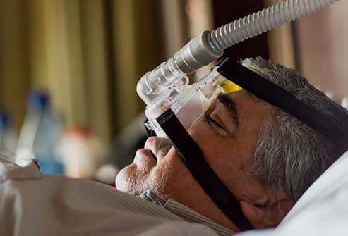 man wearing sleep apnea mask