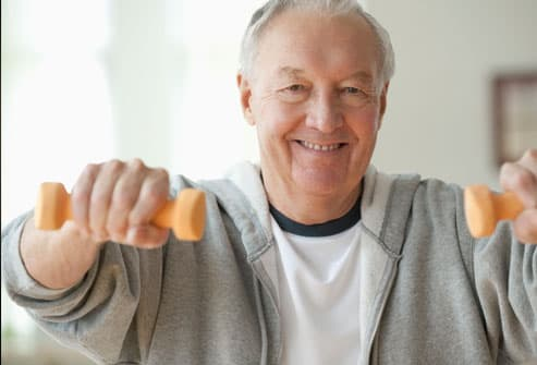 Elderly man lifting weights
