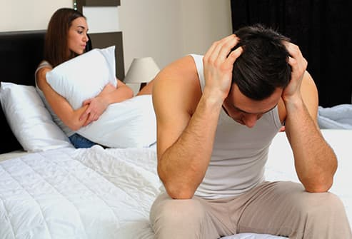 man disappointed in bed