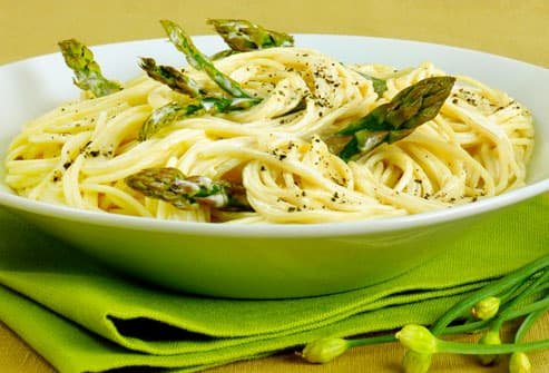 Bowl of spaghetti with asparagus