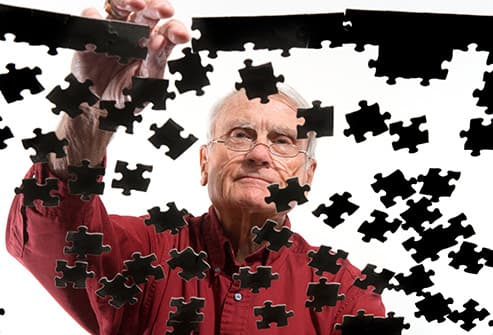 man doing puzzle