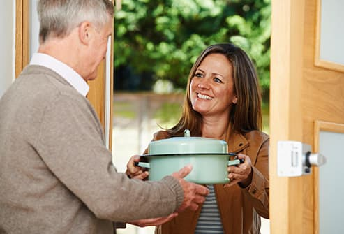 woman bringing food to friend