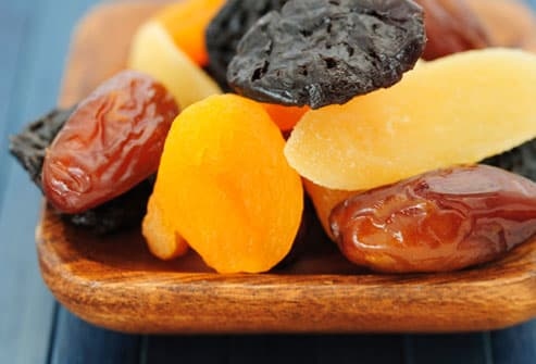 Dried fruits on wooden plate