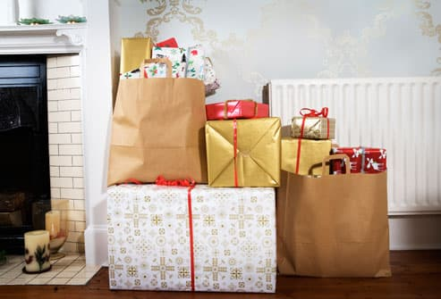 Stacks of wrapped holiday gifts
