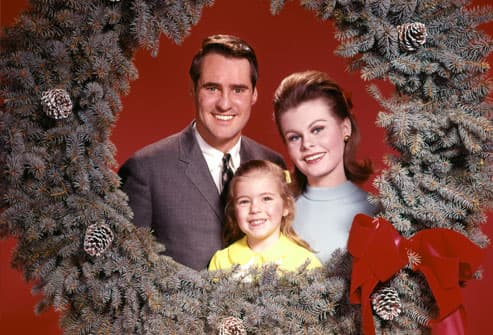 Family framed by holiday wreath circa 1960s