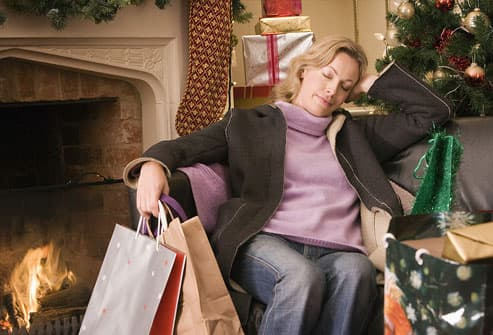 Woman napping holding holiday shopping bags