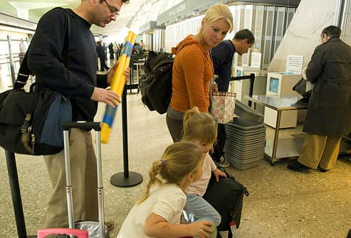 Family going through security in airport