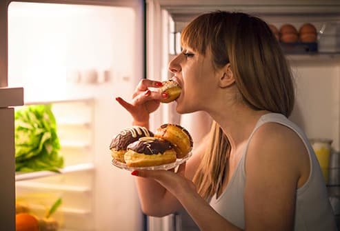 woman eating midnight snack