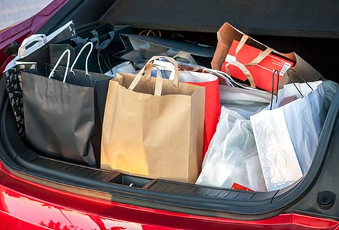 car trunk filled with shopping bags