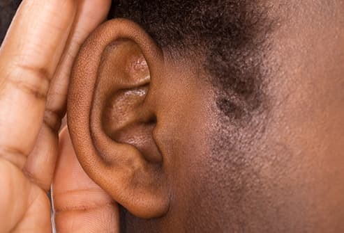 hand cupped behind ear close up