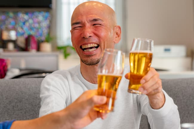 photo of man drinking beer