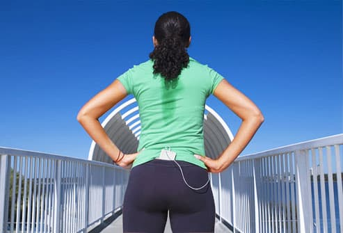 Woman taking a break while jogging