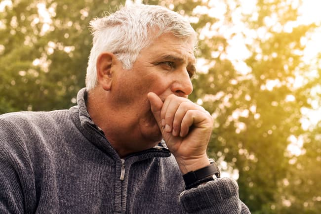 photo of person coughing