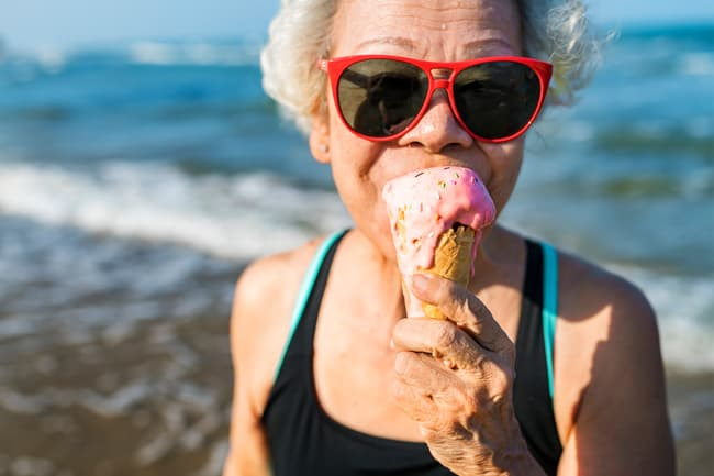photo of mature woman eating ice cream