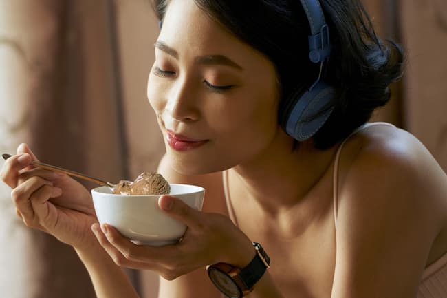 woman eating bowl of ice cream