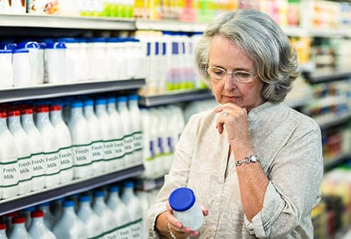 mature woman looking at label