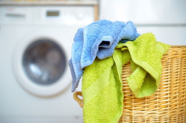 photo of towels in laundry hamper