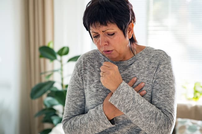mature woman coughing