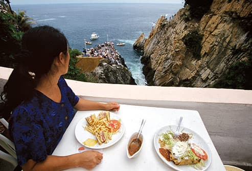 woman having meal in acapulco