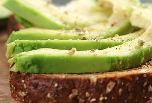 sliced avacado on rye bread