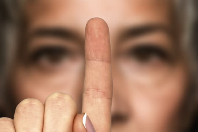 photo of woman looking at finger