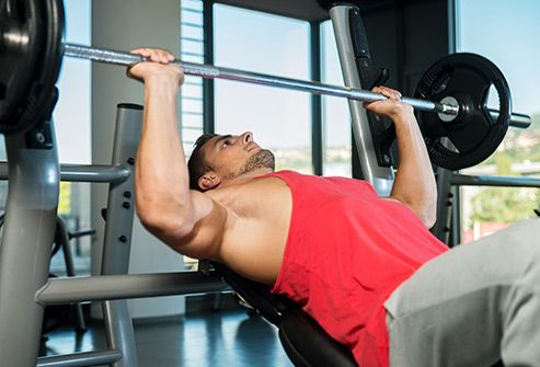 man using incline bench