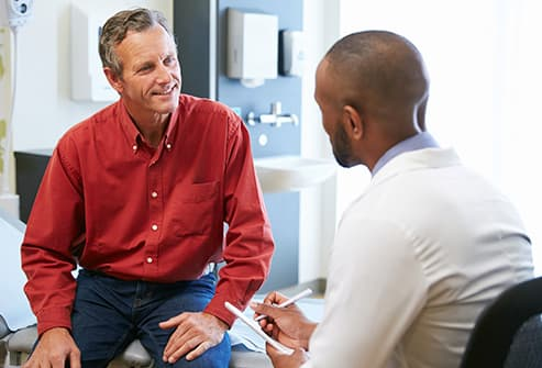 mature man talking with doctor