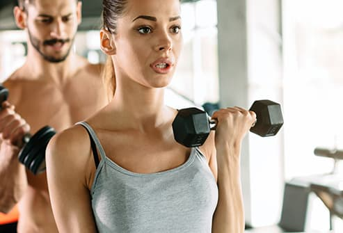 woman in gym breathing hard