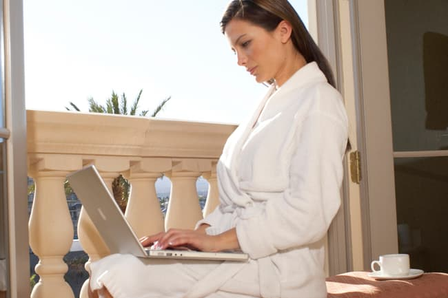 woman on computer in morning