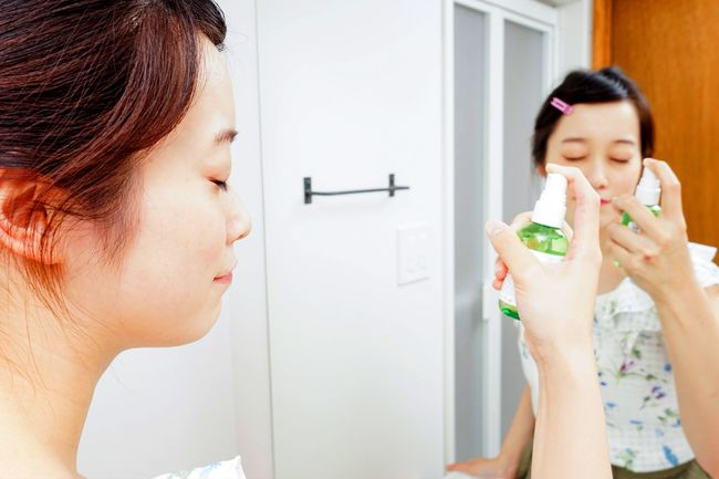 woman using mister