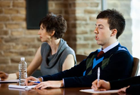 Man nodding off in a business meeting