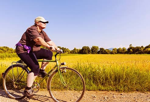 overweight woman riding bicycle