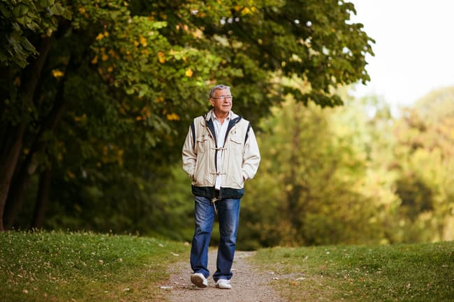 photo of mature man walking