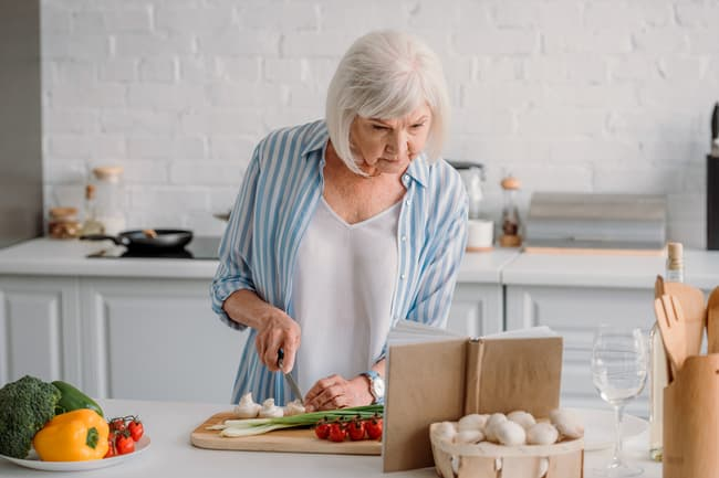 photo of mature woman cooking