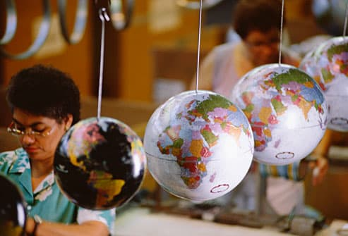 Factory workers making globes