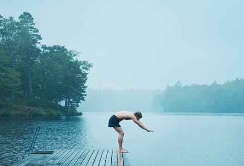 Man About to Dive in Lake