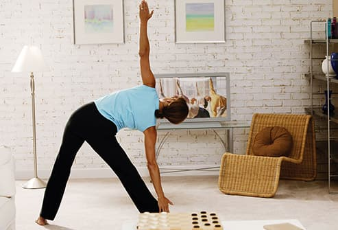 woman stretching in livingroom