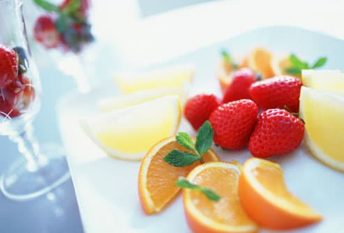Orange slice and strawberries in tray