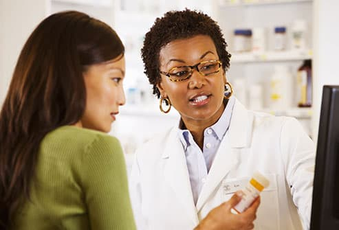 pharmacist consulting woman