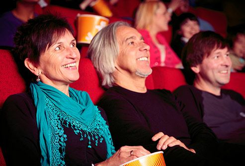 couple laughing in movie theater