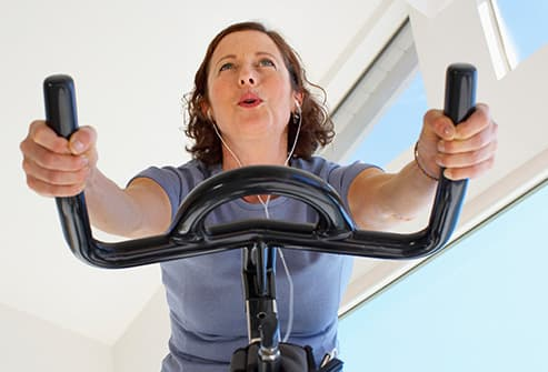 mature woman on stationary bike