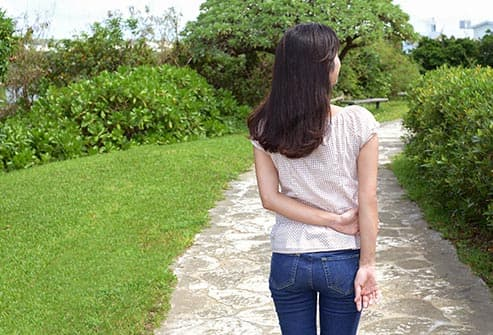 woman walking on path outdoors