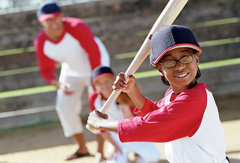 young athlete with glasses